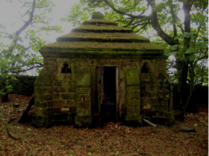 A (now demolished) mausoleum that spookily resembles a staring head at Rod Moor Cemetery, Hollow Meadows. Image Chris Hobbs.